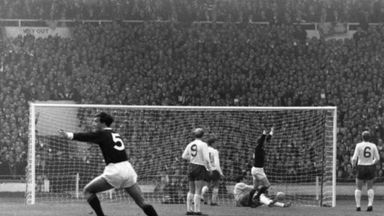 Denis Law celebrates with his arms aloft after scoring for Scotland against England at Wembley in 1967